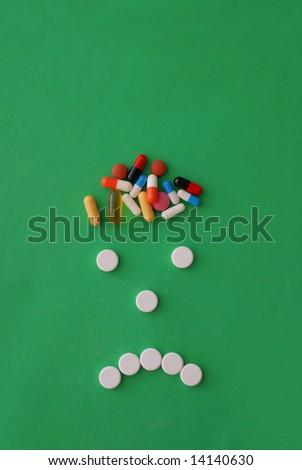 headache caricature with pills - stock photo