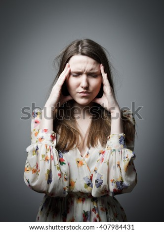 Headache. Expressions, feelings and moods. Young woman suffering from headache