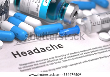 Headache. Medical Concept with Blue Pills, Injections and Syringe. Selective Focus. Blurred Background. - stock photo