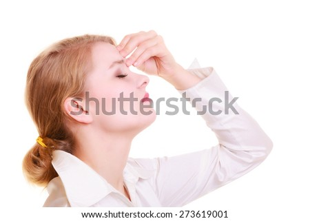 Headache, migraine and sinus ache. Stressed businesswoman worried young woman suffering from head or nose pain isolated on white. - stock photo