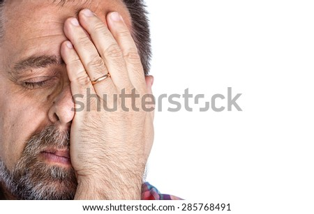 Headache. Portrait of an middle age man with face closed by hand. Isolated on white with copy-space - stock photo