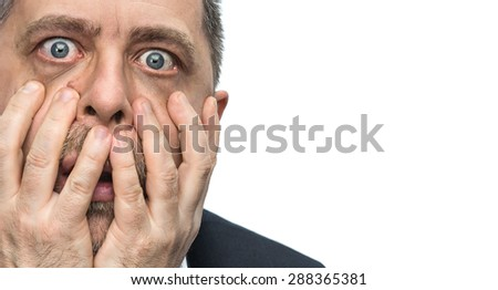 Headache. Portrait of an middle age man with face closed by hands. Isolated on white with copy-space - stock photo