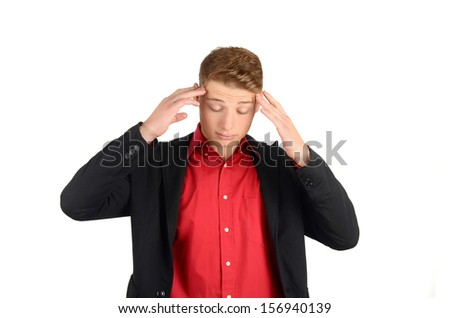 Headache, sadness, depression. Young business man holding his head down frowning, massaging his forehead trying to relax.  Isolated on white background. - stock photo
