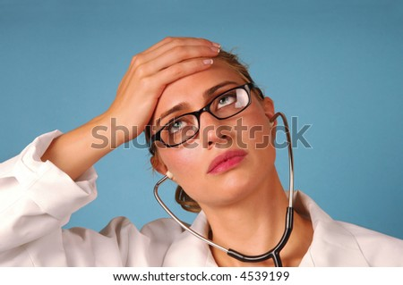 headache young female doctor stressful expression