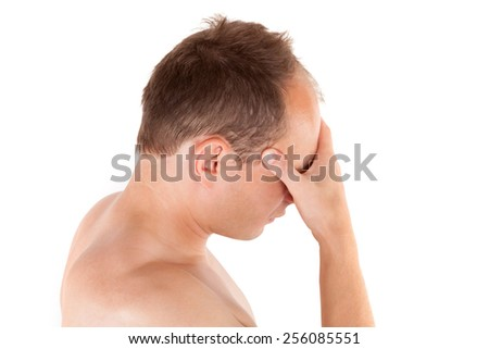Headache. Young man touching his head isolated on white background. Headache and migraine concept.  - stock photo