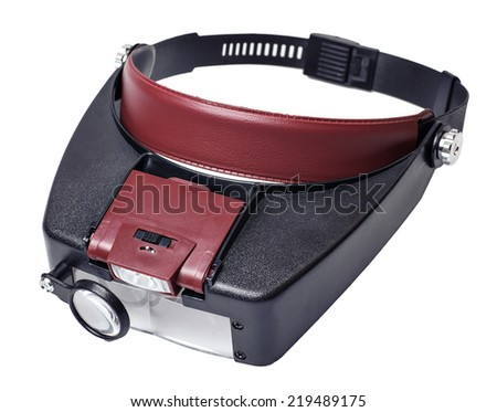 headband magnifer with detachable light source box  it is isolated on a white background - stock photo