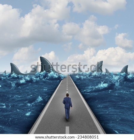 Headed for danger business concept as a man walking on a straight road towards a group of dangerous sharks as a metaphor and symbol of risk and courage from a person on a career path or life journey. - stock photo