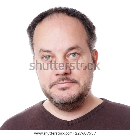 headhsot of a middle aged man with beard stubble