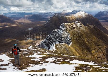 Heading down towards the three horns on Ben Alligin Ridge in the Torridon Mountains, Scottish Highlands. - stock photo