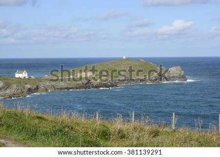 Headland into the Atlantic Ocean at Newquay in Cornwall, England - stock photo