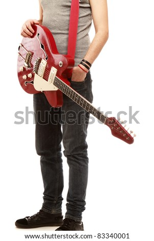 Headless rocker with his classic acoustic guitar against white background - stock photo