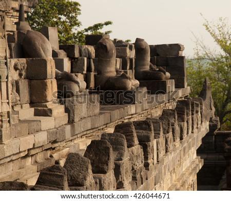 Headless statues at Borobudur temple in Yogyakarta, Java, Indonesia. - stock photo