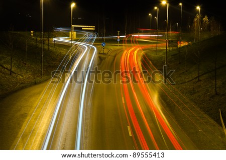 Headlight and taillight trails at night in a roundabout