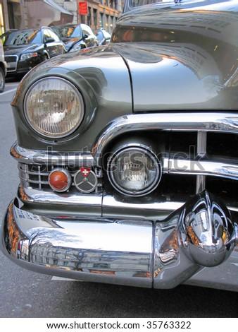 Headlight of a luxury old car - stock photo