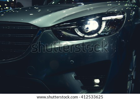 Headlight of a modern luxury car, auto detail,car care concept - stock photo