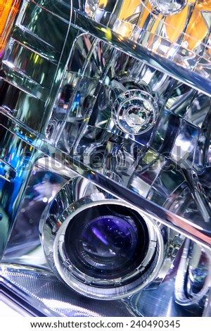 Headlight of big sub, colorful details of car in abstract style, close-up - stock photo