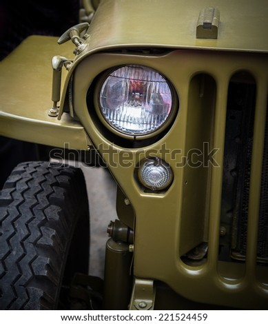 Headlight on a old military vehicle, closeup. Selective focus with shallow depth of field.
