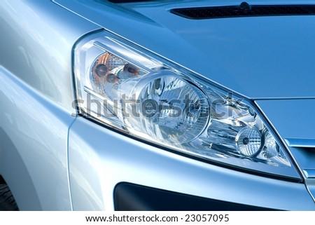 Headlights of a New Car - stock photo