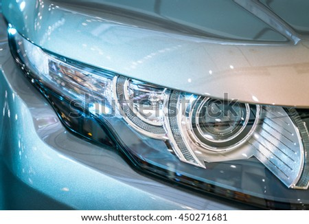 Headlights of car - stock photo