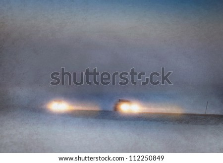 Headlights of cars driving in heavy snow storm - stock photo