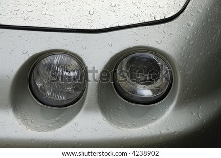 Headlights of man automobile ona rainy day - stock photo