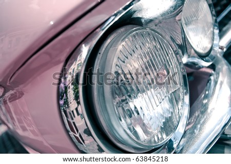 Headlights of the pink retro car.