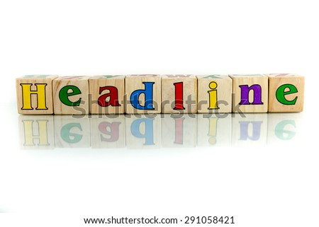 headline colorful wooden word block on the white background