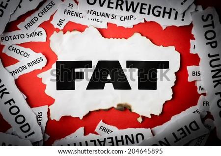 Headlines FAT, junk food, overweight, diabetes, unhealthy etc. - stock photo
