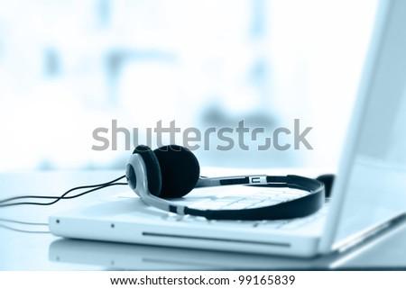 Headphone and keyboard - stock photo