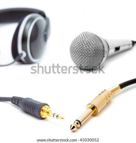 headphone and microphone with connector isolated on white - stock photo