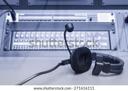 Headphone with Music mixer control desk in studio - stock photo