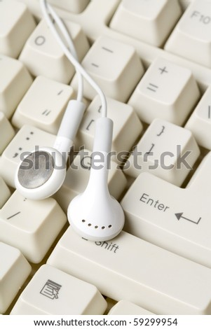 Headphones and keyboard, concept of digital music