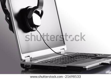 Headphones and laptop - stock photo