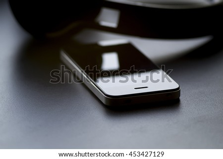 headphones and phone on a black background