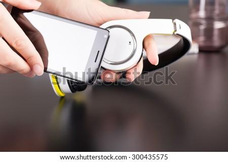 Headphones and smartphone, wireless communication - stock photo