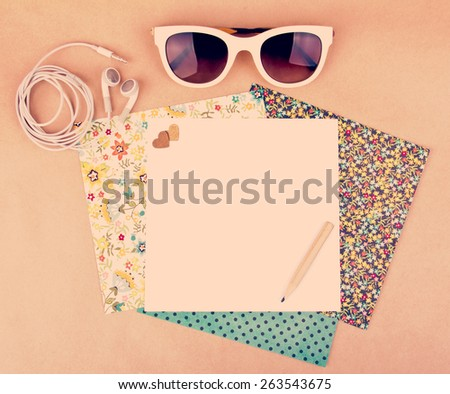 headphones and sunglasses with a set of pattern paper. Vintage style edition. Instagram filter toning. Place for your text. Decorated with small hearts. - stock photo