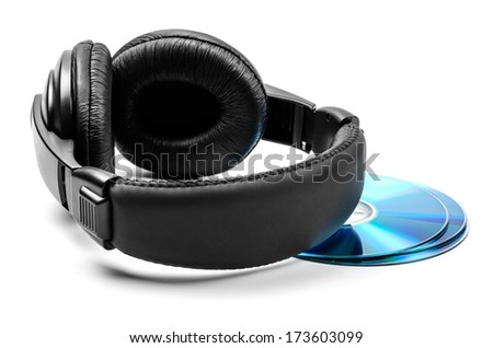 Headphones and three disks on white background