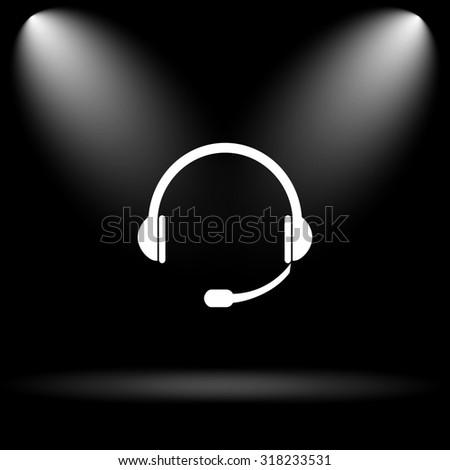 Headphones icon. Internet button on black background. - stock photo