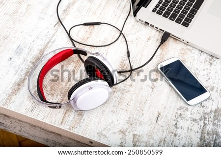 Headphones in the office	 - stock photo