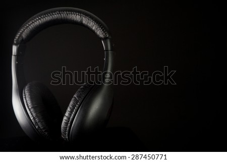 Headphones on a black background - stock photo