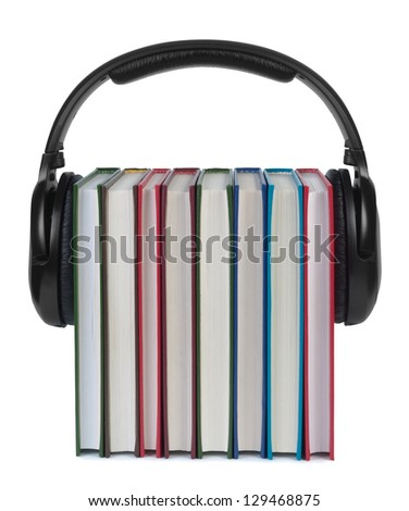 Headphones on books isolated white background. Concept of e-learning and listening to audiobooks. - stock photo