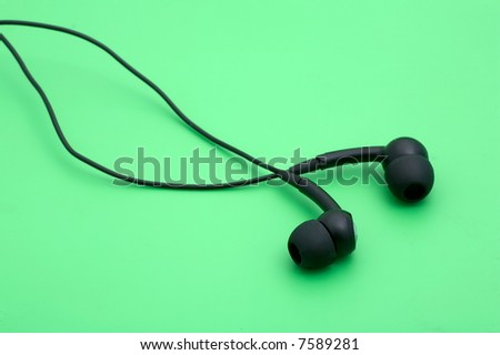 headphones on green background