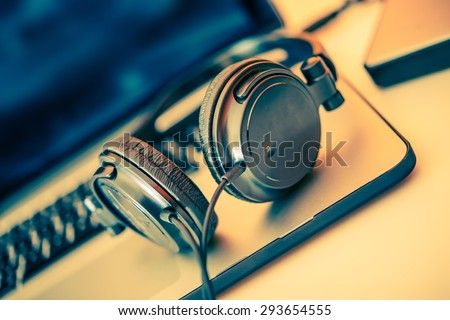 Headphones on Laptop Computer. Online Music Listening. Music Concept. - stock photo