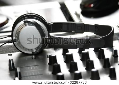 headphones on sound mixer - stock photo