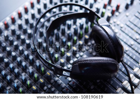 Headphones on soundmixer - stock photo