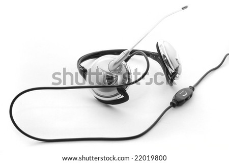 Headphones with a boom microphone and volume control isolated