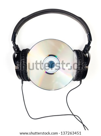 Headphones with CD on white background - stock photo