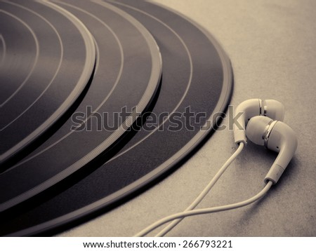 headphones with old disc - music concept - - stock photo