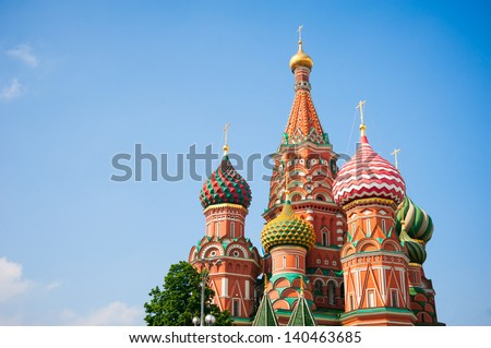 Heads of St. Basil's Cathedral and blue sky, Moscow, Russia - stock photo