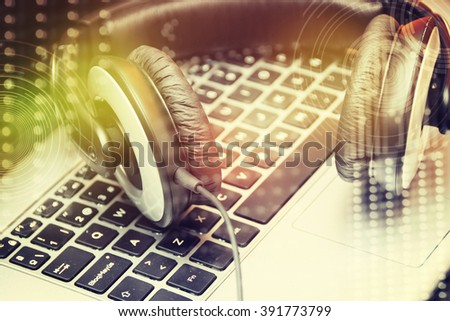 headset on laptop computer keyboard concept for communication - stock photo